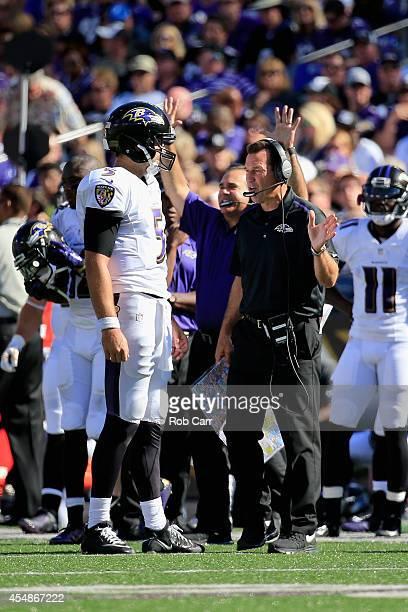 Quarterback Joe Flacco of the Baltimore Ravens speaks with offensive coordinator Gary Kubiak during an NFL football game against the Cincinnati...