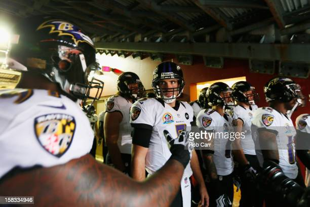 Quarterback Joe Flacco of the Baltimore Ravens stands with teammates before the Ravens were introduced prior to the start of their game against the...