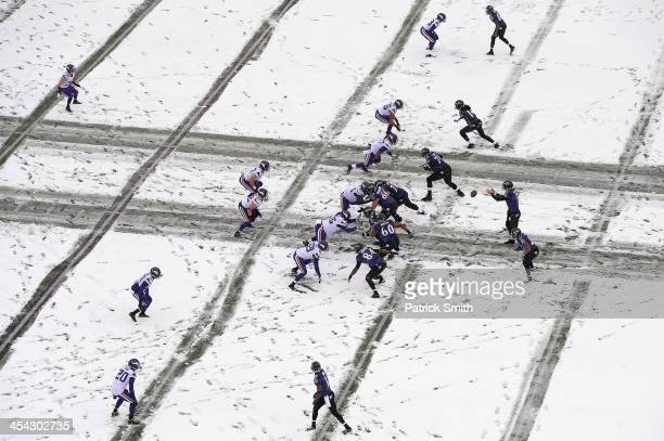 Quarterback Joe Flacco of the Baltimore Ravens takes a snap against the Minnesota Vikings in the first quarter at MT Bank Stadium on December 8 2013...
