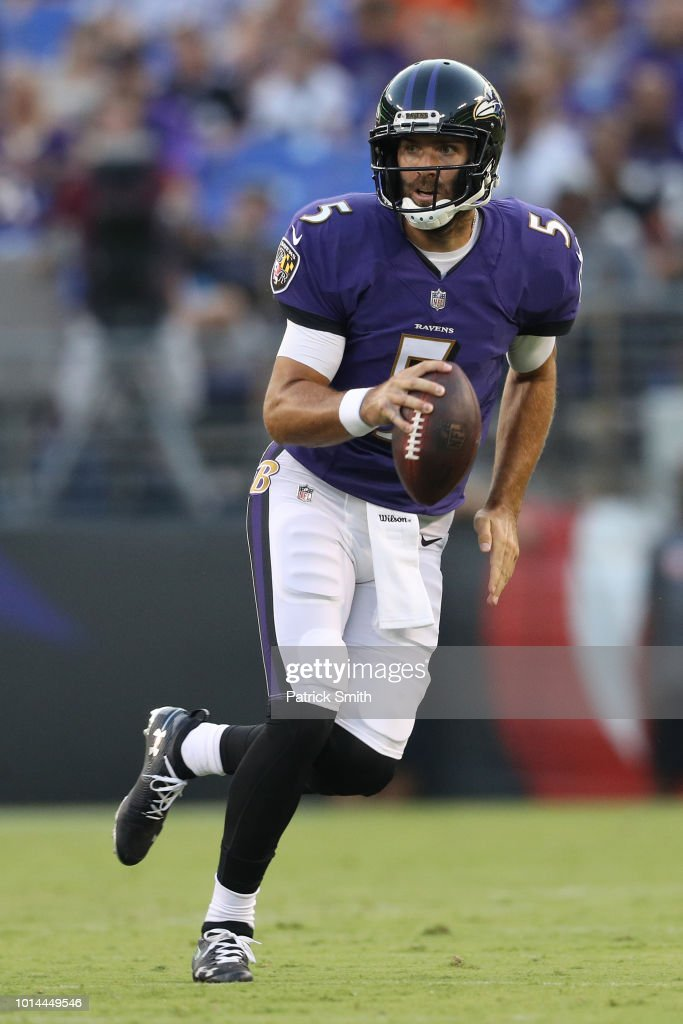 Quarterback Joe Flacco #5 of the Baltimore Ravens throws a pass against the Los Angeles Rams in the first half during a preseason game at M&T Bank Stadium on August 9, 2018 in Baltimore, Maryland.
