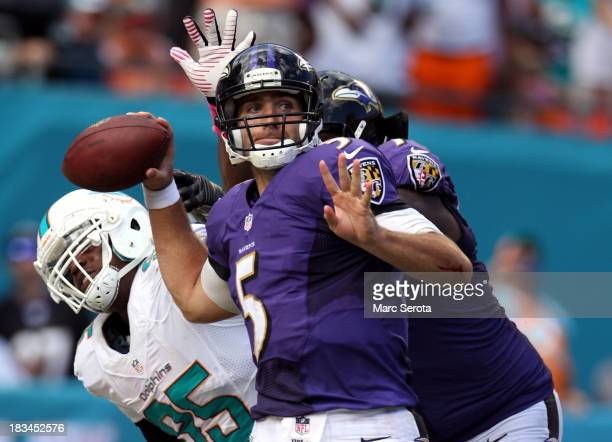 Quarterback Joe Flacco of the Baltimore Ravens throws against the Miami Dolphins at Sun Life Stadium on October 6 2013 in Miami Gardens Florida The...