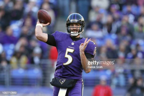 Quarterback Joe Flacco of the Baltimore Ravens throws the ball in the third quarter against the New Orleans Saints at MT Bank Stadium on October 21...