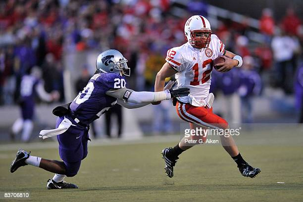 Quarterback Joe Ganz of the Nebraska Cornhuskers rushes past strong safety Courtney Herndon of the Kansas State Wildcats enroute to a 25yard...