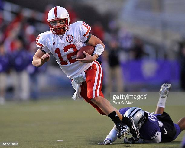 Quarterback Joe Ganz of the Nebraska Cornhuskers rushes past strong safety Courtney Herndon of the Kansas State Wildcats enroute to a 25 yard...