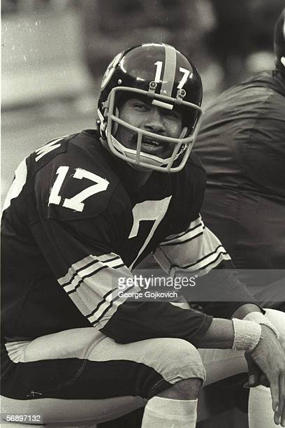 Quarterback Joe Gilliam of the Pittsburgh Steelers sits on the bench during a game against the Oakland Raiders at Three Rivers Stadium on September...
