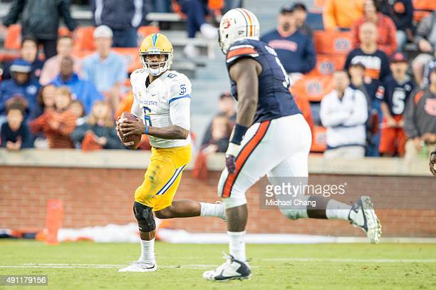 Quarterback Joe Gray of the San Jose State Spartans looks to throw a pass in front of defensive tackle Montravius Adams of the Auburn Tigers on...
