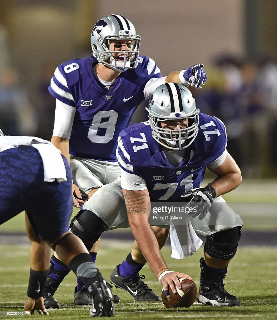 Quarterback Joe Hubener #8 of the Kansas State Wildcats calls out instructions against the TCU Horned Frogs during the first half on October 10, 2015 at Bill Snyder Family Stadium in Manhattan, Kansas.