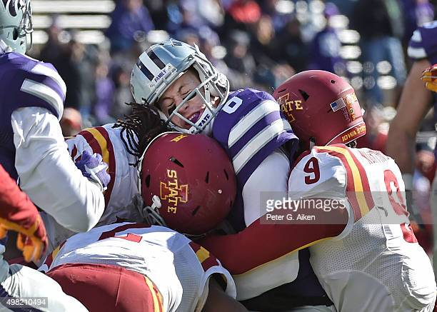 Quarterback Joe Hubener of the Kansas State Wildcats gets tackled by defensive back Reggan Northrup of the Iowa State Cyclones during the second half...