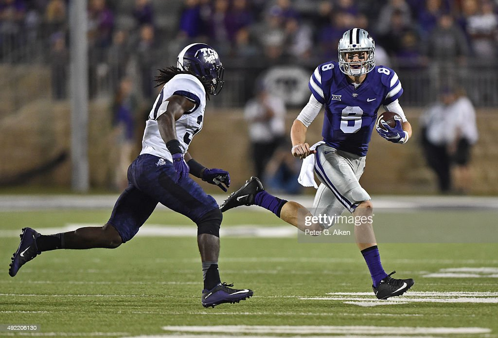 Quarterback Joe Hubener #8 of the Kansas State Wildcats rushes to the outside against strong safety Denzel Johnson #30 of the TCU Horned Frogs during the second half on October 10, 2015 at Bill Snyder Family Stadium in Manhattan, Kansas.