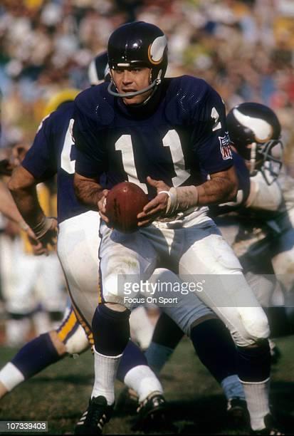 Quarterback Joe Kapp of the Minnesota Vikings drops back to pass during an NFL football game at Metropolitan Stadium circa 1969 in Minneapolis...