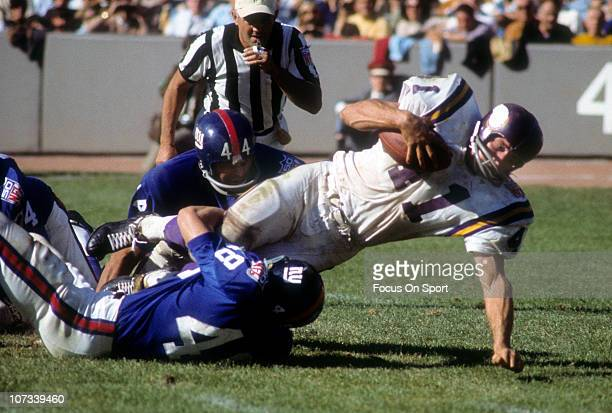 Quarterback Joe Kapp of the Minnesota Vikings is tackled by Al Brenner of the New York Giants during an NFL football game at Yankee Stadium September...