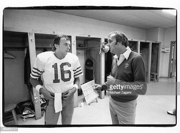 Quarterback Joe Montana and quarterbacks coach Sam Wyche of the San Francisco 49ers talk in the locker room before the game against the Pittsburgh...