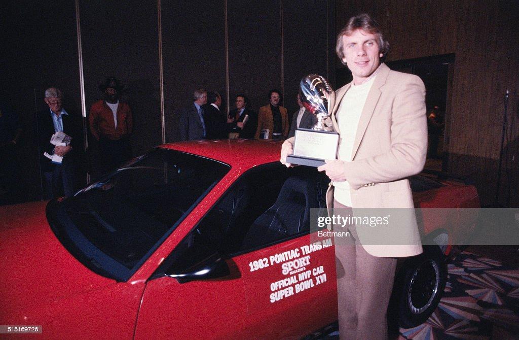 Joe Montana Holds Trophy : News Photo