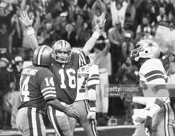 Quarterback Joe Montana of the San Francisco 49ers celebrates after 49ers kicker Ray Wersching kicks the winning extra point to defeat the Dallas...