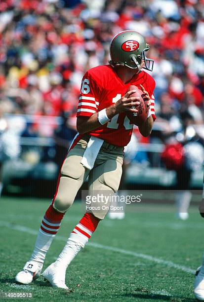 Quarterback Joe Montana of the San Francisco 49ers drops back to pass against the New Orleans Saints during an NFL football game at Candlestick Park...