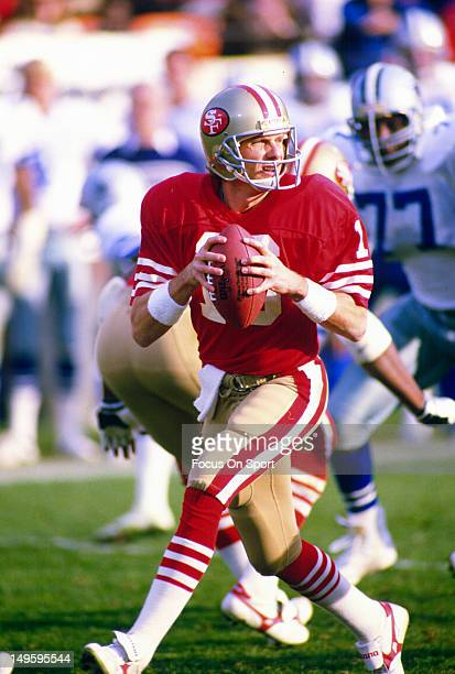 Quarterback Joe Montana of the San Francisco 49ers drops back to pass against the Dallas Cowboys during an NFL football game at Candlestick Park on...