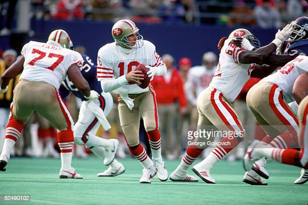 Quarterback Joe Montana of the San Francisco 49ers drops back to pass against the New York Giants during a NFC Divisional Playoff game at Giants...