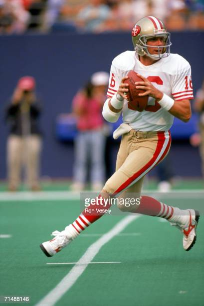 Quarterback Joe Montana of the San Francisco 49ers drops back to pass against the New York Giants at Giants Stadium on September 11 1988 in East...