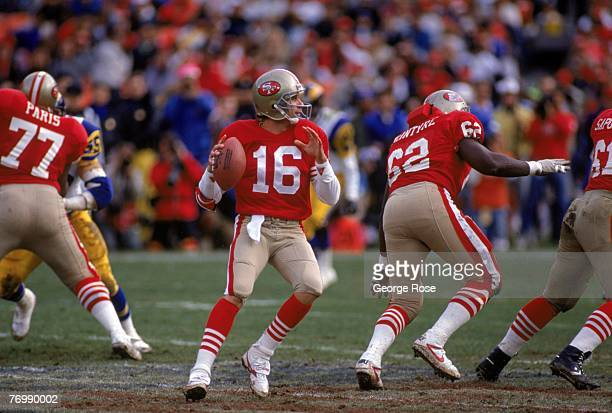 Quarterback Joe Montana of the San Francisco 49ers drops back to pass under the protection of offensive tackle Bubba Paris and guard Guy McIntyre...