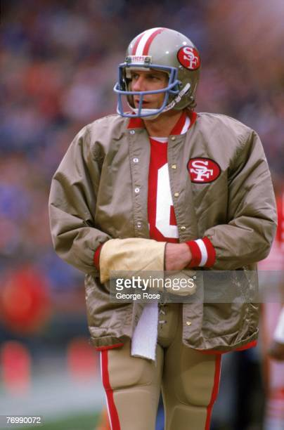 Quarterback Joe Montana of the San Francisco 49ers keeps his hands warm as he paces the sideline during the 1984 NFC Divisional Playoff game against...