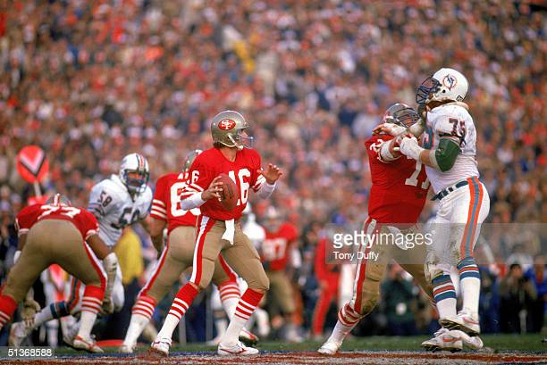 Quarterback Joe Montana of the San Francisco 49ers looks to pass during Super Bowl XIX against the Miami Dolphins at Stanford Stadium on January 20,...