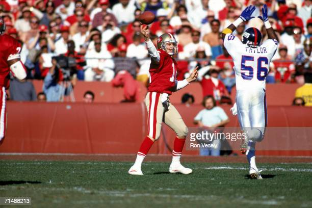 Quarterback Joe Montana of the San Francisco 49ers passes under pressure from linebacker Lawrence Taylor of the New York Giants during the 1990 NFC...