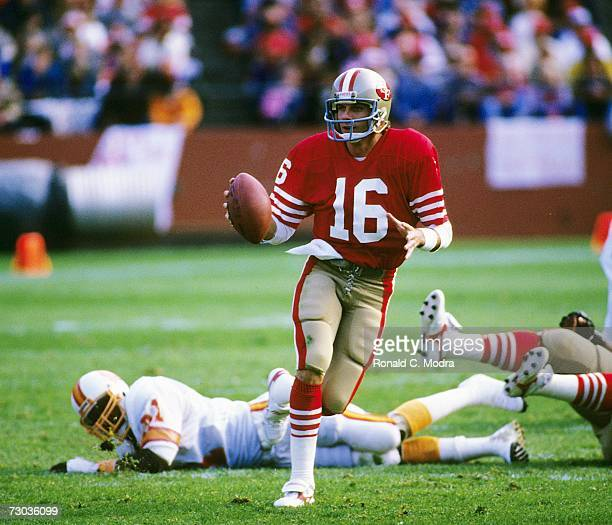 Quarterback Joe Montana of the San Francisco 49ers scrambling in a game against the Tampa Bay Buccaneers on November 18, l984 in san Francisco,...