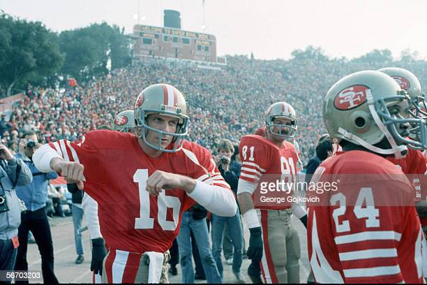 Quarterback Joe Montana of the San Francisco 49ers stretches while waiting to be introduced before the start of Super Bowl XIX against the Miami...