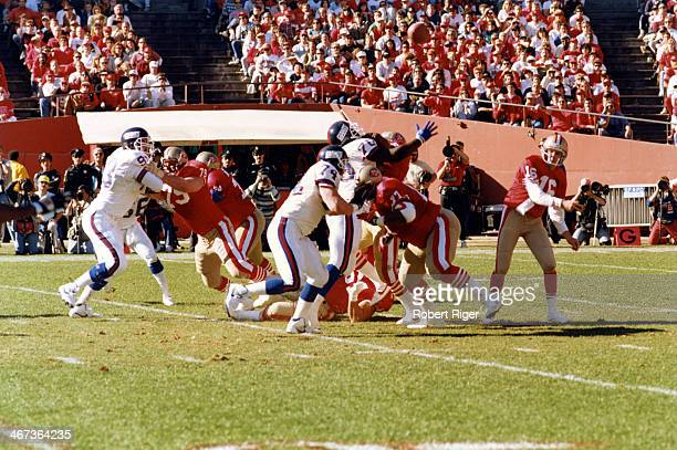 Quarterback Joe Montata of the San Francisco 49ers throws the ball during the 1990 1991 NFC Championship Game against the New York Giants at...