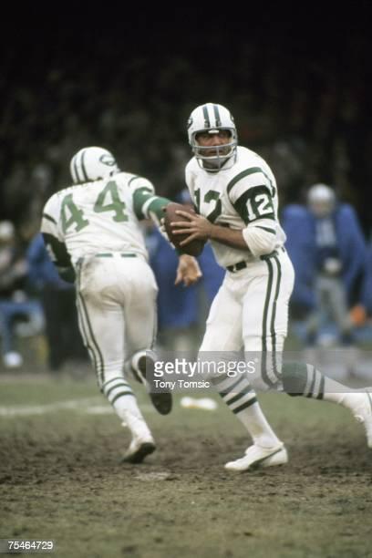 Quarterback Joe Namath of the New York Jets drops back to pass as runningback John Riggins runs a pass pattern during a game in November 23 1972...
