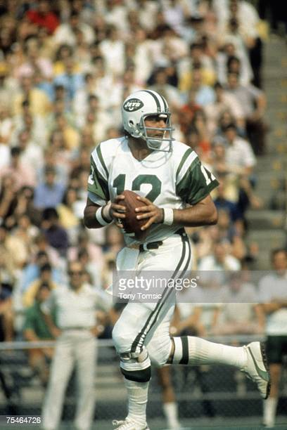 Quarterback Joe Namath of the New York Jets drops back to pass during a game on September 24 1972 against the Baltimore Colts at Memorial Stadium in...