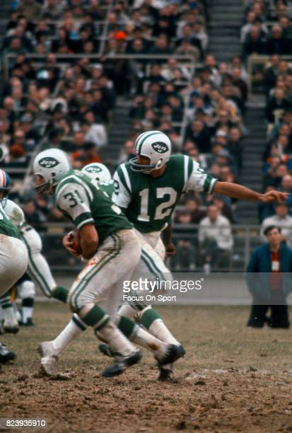 Quarterback Joe Namath of the New York Jets hands off to running back Bill Mathis against the Denver Broncos during an AFL football game October 13...