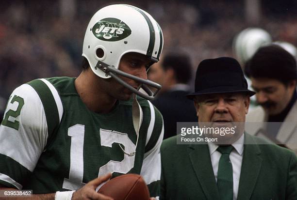 Quarterback Joe Namath of the New York Jets talks with head coach Weeb Ewbank on the sidelines during an AFL football game circa 1967 at Shea Stadium...