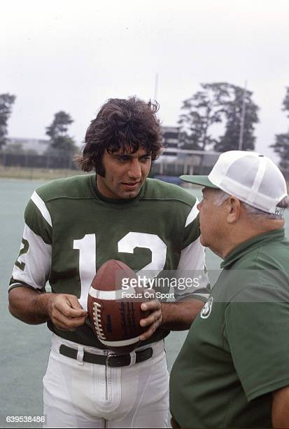 Quarterback Joe Namath of the New York Jets talks with head coach Weeb Ewbank during a practice circa 1971 in New York City Namath played for the...