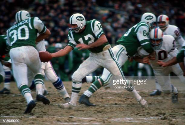 Quarterback Joe Namath of the New York Jets turns to hand off to running back Mark Smolinski against the Buffalo Bills during an AFL football game...