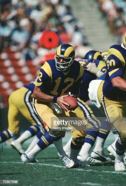 Quarterback Joe Namath of the LA Rams drops back in the pocket to turn the hand off during a game at the LA Memorial Coliseum in Los Angeles...