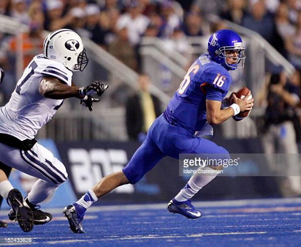 Quarterback Joe Southwick of Boise State evades pressure from Ezekiel Ansah of Brigham Young at Bronco Stadium in Boise Idaho on Thursday September...