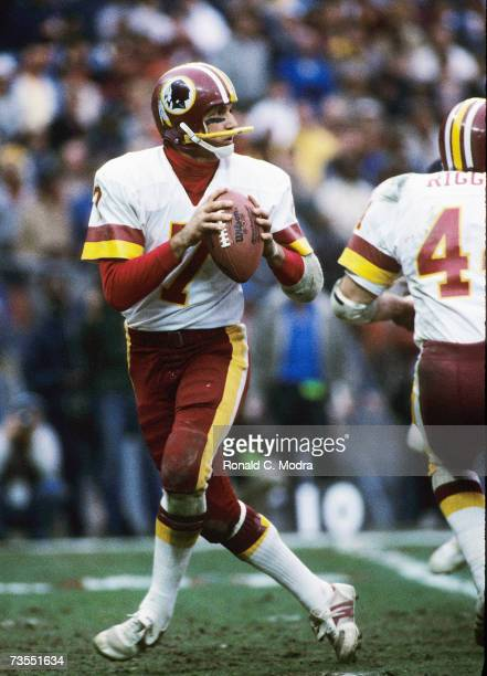 Quarterback Joe Theisman of the Washington Redskins goes back to pass in the NFC Divisional Playoff Game against the Chicago Bears on December 30...