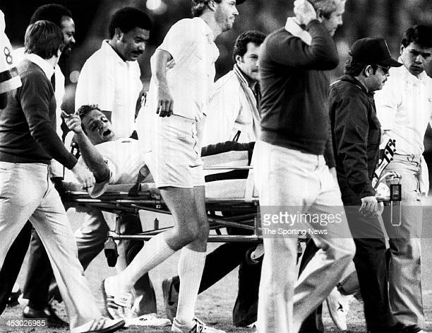 Quarterback Joe Theismann of the Washington Redskins is taken off of the field after he was injured suffering from a comminuted compound fracture of...