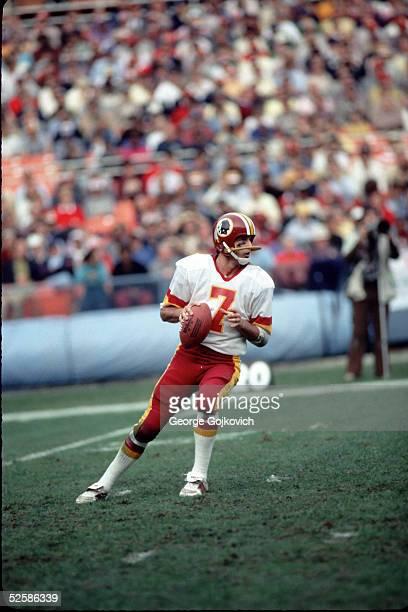 Quarterback Joe Theismann of the Washington Redskins passes during a game at RFK Stadium in December 1983 in Washington DC