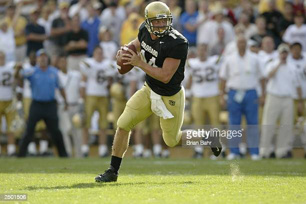 Quarterback Joel Klatt of the Colorado Buffaloes rolls out to throw the gamewinning touchdown against the UCLA Bruins on September 6 2003 at Folsom...