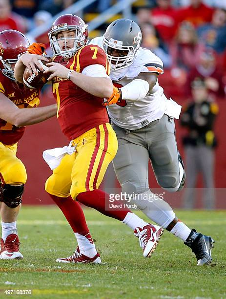 Quarterback Joel Lanning of the Iowa State Cyclones is sacked by defensive end Emmanuel Ogbah of the Oklahoma State Cowboys in the first half of play...