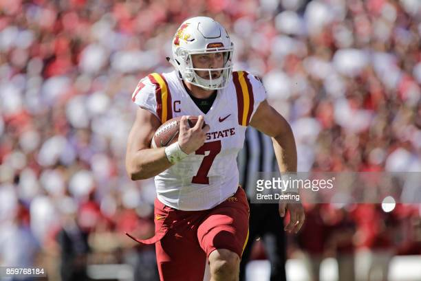 Quarterback Joel Lanning of the Iowa State Cyclones looks for a opening against the Oklahoma Sooners at Gaylord Family Oklahoma Memorial Stadium on...