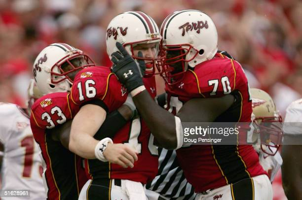 Quarterback Joel Statham of the University of Maryland Terrapins celebrates his 1-yard third quarter touchdown with Stephon Heyer and Josh Allen as...