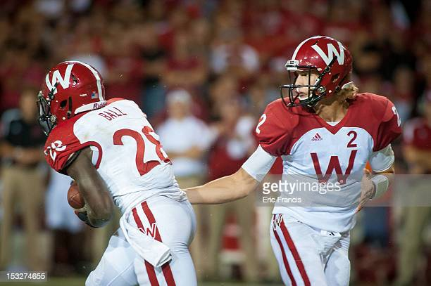 Quarterback Joel Stave of the Wisconsin Badgers hands the ball to teammate running back Montee Ball of the Wisconsin Badgers during their game...