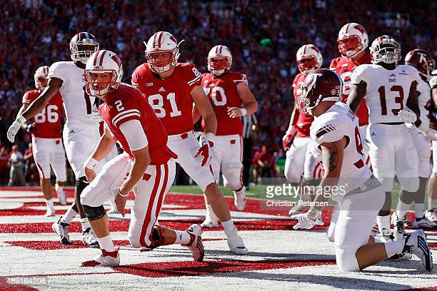 Quarterback Joel Stave of the Wisconsin Badgers reacts after scoring on a four yard rushing touchdown against the Troy Trojans during the second...