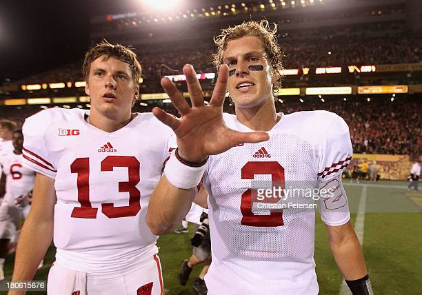 Quarterback Joel Stave of the Wisconsin Badgers reacts as he walks off the field following a 3230 defeat to the Arizona State Sun Devils in the...