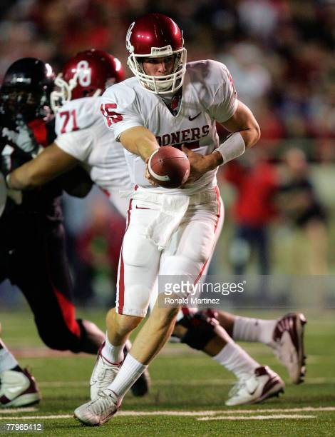 Quarterback Joey Halzle of the Oklahoma Sooners hands the ball off against the Texas Tech Red Raiders in the first quarter at Jones ATT Stadium on...