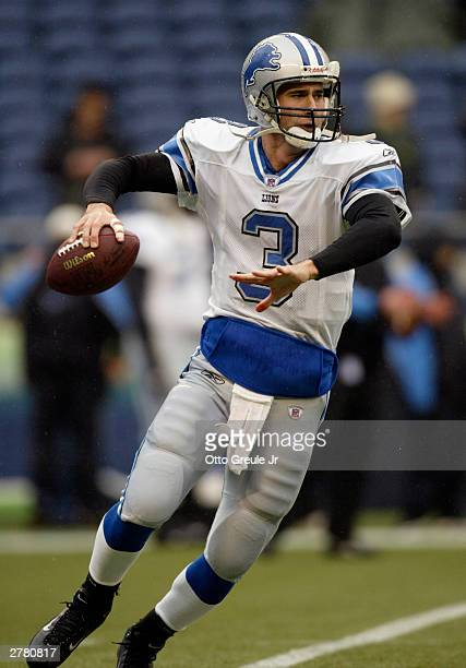 Quarterback Joey Harrington of the Detroit Lions looks to throw the ball during the game against the Seattle Seahawks on November 16 2003 at Seahawks...