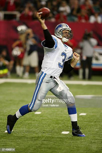 Quarterback Joey Harrington of the Detroit Lions sets to pass during the game against the Atlanta Falcons at the Georgia Dome on October 10, 2004 in...